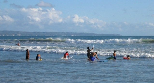 Youngsters trying smaller waves at Legian