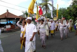 Procession to the temple, lead by priest in white