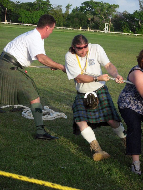 Piper Duncan and Jock from Killin Thyme band give a hand at the Tug o War at the Highland Games at The Garrison