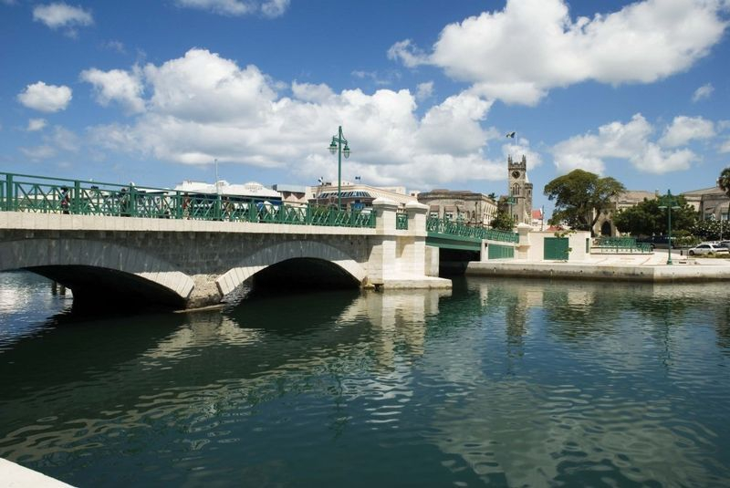 The Careenage in Bridgetown with the Swing Bridge in the foreground and the Parliament in the background