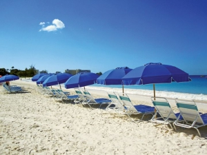 Rent a beach chair and umbrella, the best beach day of your cruise!
