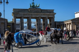 Bikes, people, and horses at the Brandenburger Tor