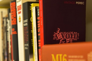 a shelf full of books... gotta be some clues here!