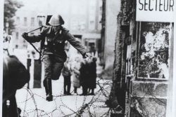 East German Soldier escapes over Berlin Wall