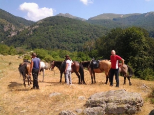 Beautiful mountains, resting horses and riders, a warm reunion with nature