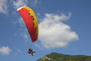 Blue sky paragliding over magnificent mountains - discover the beauty of earth from high above
