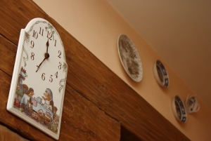 Cheerful wall clock and decorative plates
