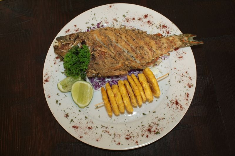 Fried fish Boca Chica style with Tostones
