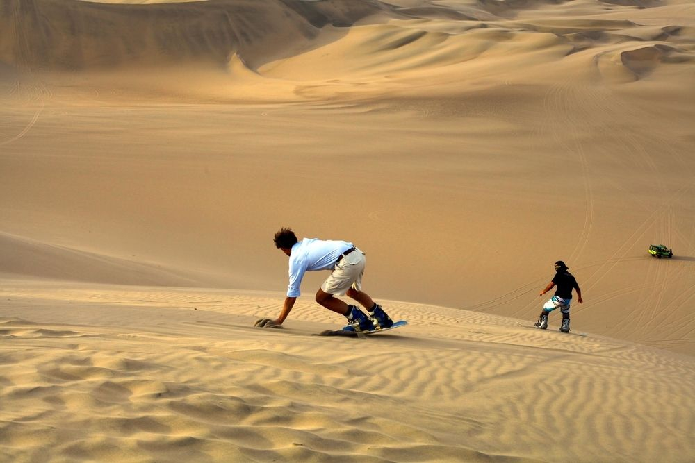 Boarding down a dune