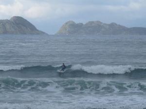 Surfing Patos Beach facing Cies Islands