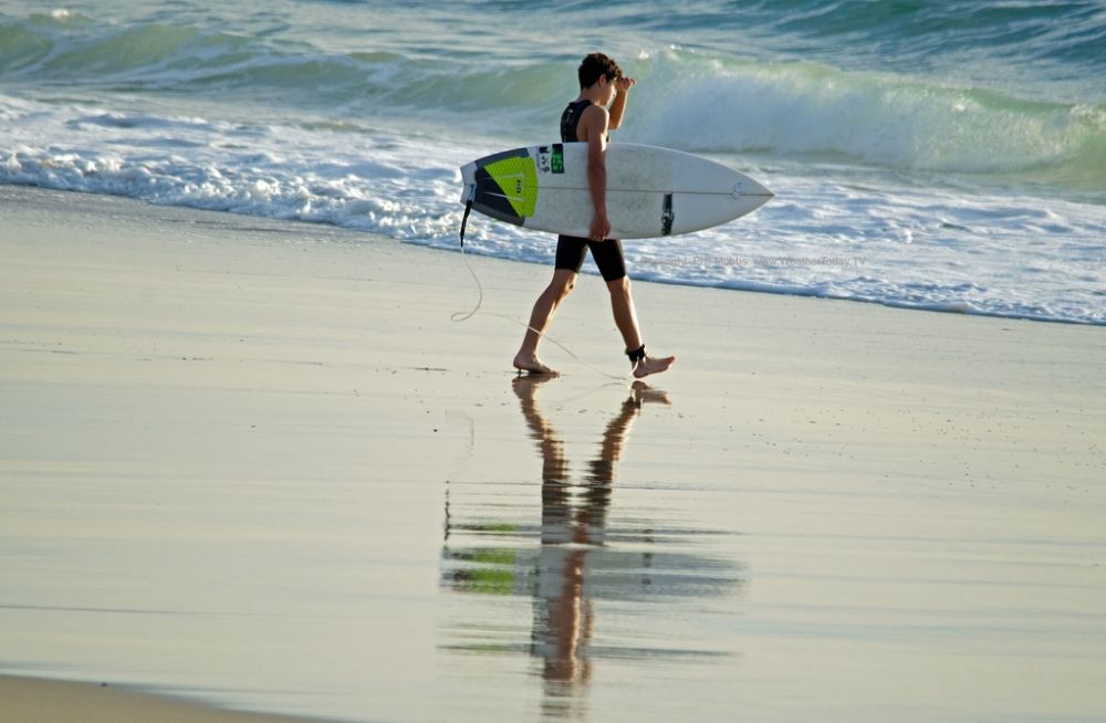 Headed for an early morning surf