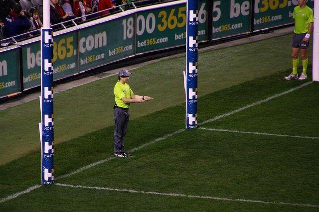A goal umpire calls a goal