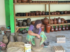 Local woman making clay pots