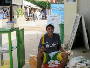 Man selling bbqed corn