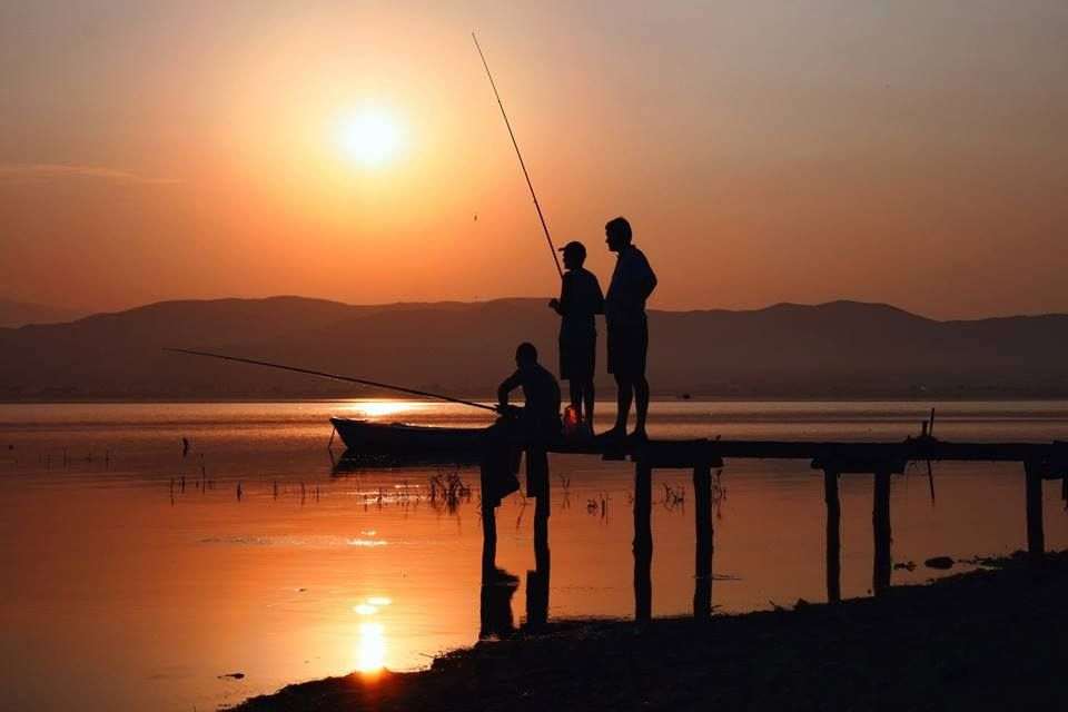 Fishermen on a Dock
