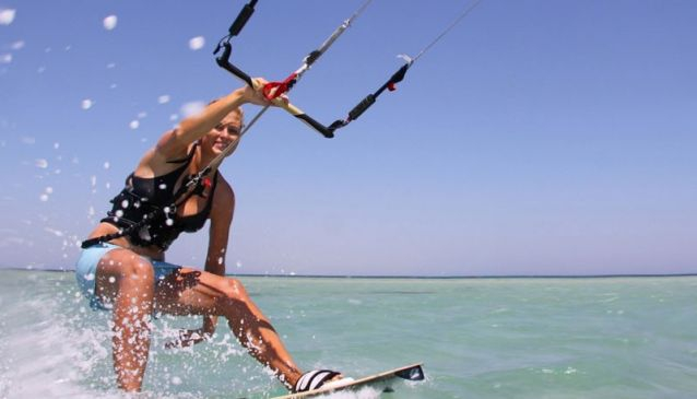 Drive to Tarifa and try kite-surfing on the white sandy beaches
