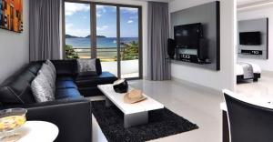 Living room with terrace overlooking Kamala Bay