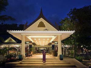 The hotel's front facade & entrance at night