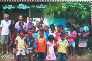 Kids and volunteers at Home & Life Foundation