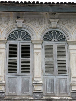 Set of shuttered windows on a house in in Old Phuket Town
