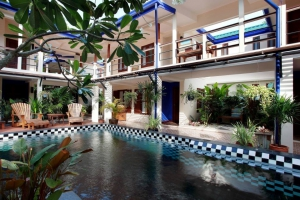 Rooms surround the swimming pool