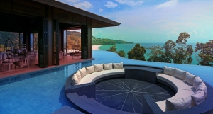 Outdoor sunken lounge in a pool with a view of Naithon Bay