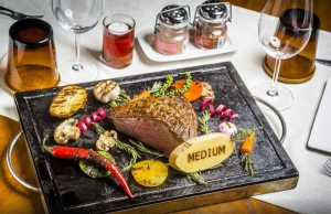 Roast beef & vegetables on a stone platter
