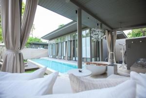 A villa pool & outdoor seating area