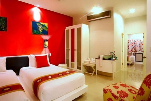 Comfortable guest room with a red theme