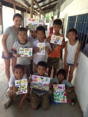 Kids showing school artwork