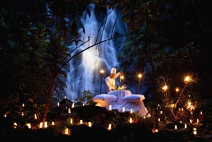 Romantic candlelit dinner next to a jungle waterfall