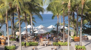 Dining under the palm trees by the beach