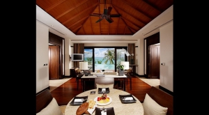 Dining living area with pool in the background