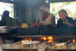 Preparing local delicacies at