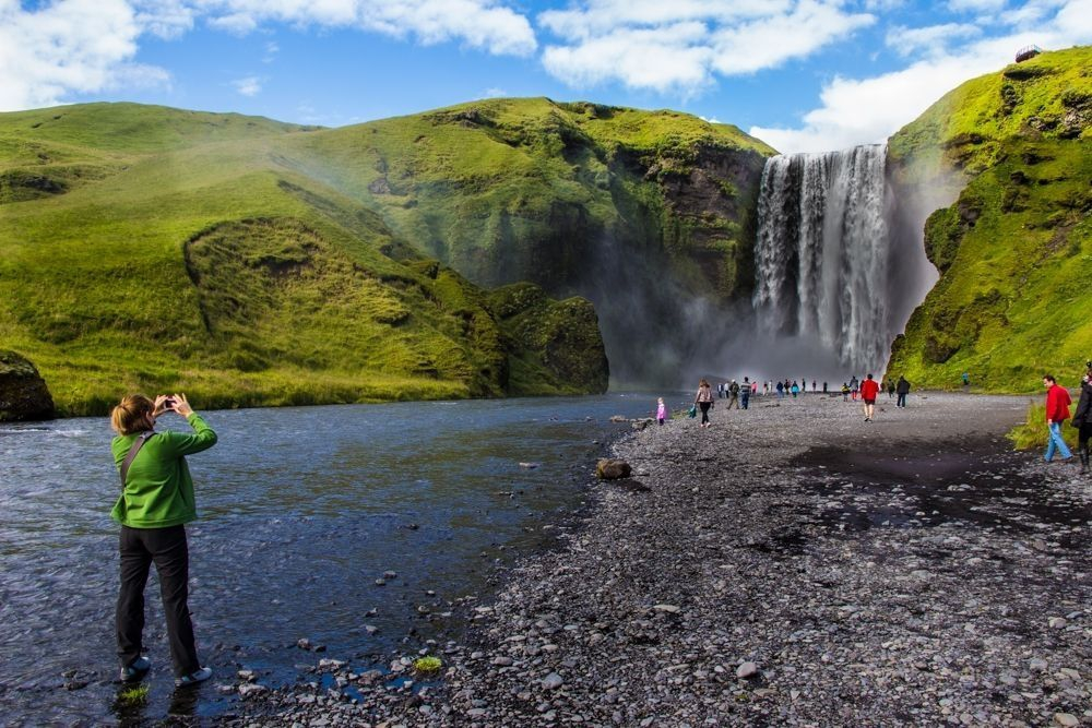 Skógafoss waterfall, on the South Coast, is a awe-inspiring and magnificent.