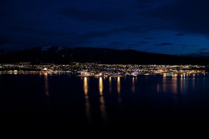 Akureyri, Iceland, at night accross the ocean.