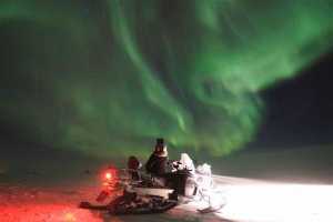 Snowmobile in Northern Lights