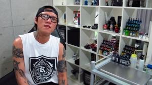 Tattoo artist Key