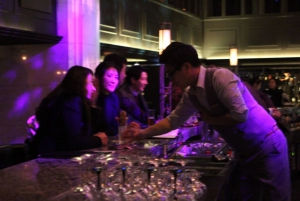 Bartender serving two girls