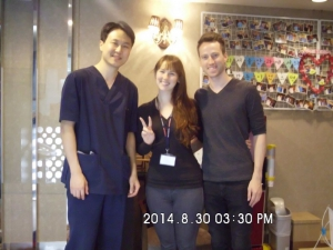 Happy patient Stephanie in the middle