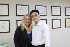Doctor Choi posing with Hollywood actress Dotty Carey in his office