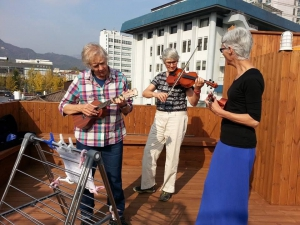 Guests playing music on the roof top