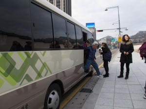 Getting off our bus in front of the main palace in Seoul