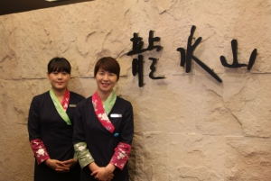 Smiling staff at front desk