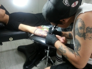 Tattooist Key in action