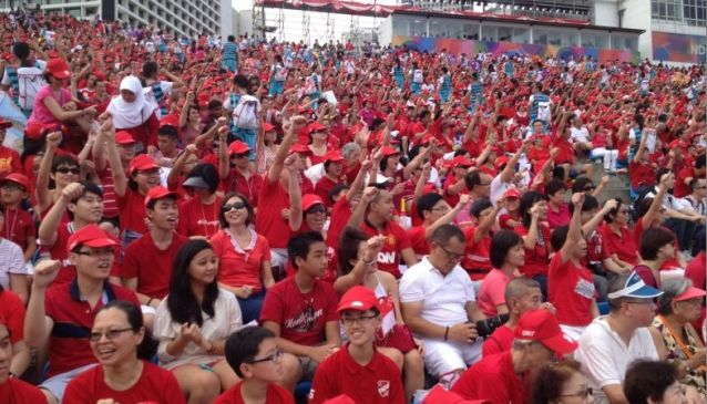 Singaporeans during a National Day Celebration. Photo Courtesy Todayonline.com