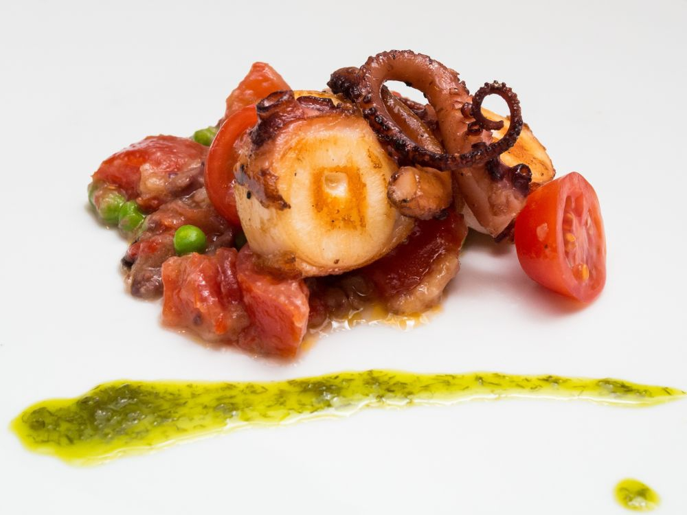 "Ola - Spanish Octopus a la plancha"" with peas, tomatoes and black olives- Photo Courtesy Savour"