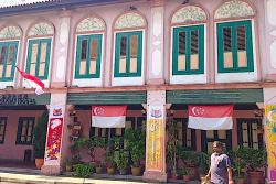 Decorated house in Little India with National Day flags
