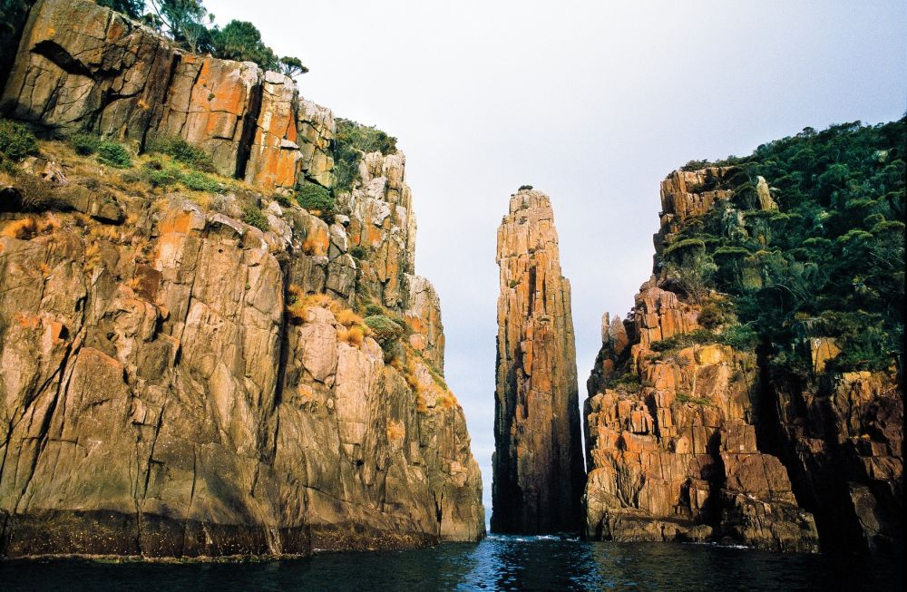 The Lanterns & the Candlestick at the tip of Cape Hauy, Tasman Peninsula. Copyright: Tourism Tasmania & Joe Shemesh