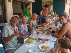 Happy customers at Scampis Tenerife Fish and Chips